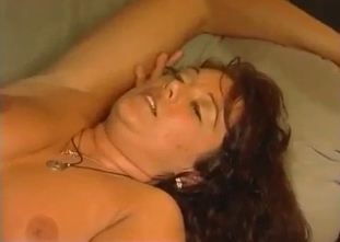 Curly-haired mommy takes her son's huge cock