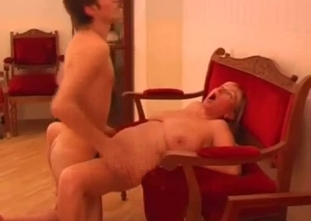 Ponytailed fat-ass MILF rides her son's cock