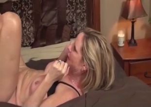 Black top blonde rides her son's massive cock