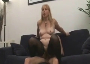 Blond-haired bombshell sucking her brother's dick